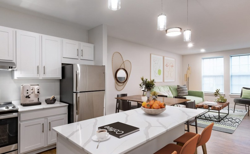 spacious kitchen with a long island and on wood-style flooring