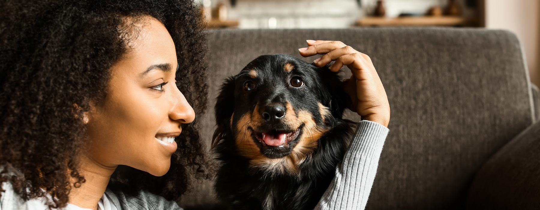 lifestyle image of a woman embracing a dog