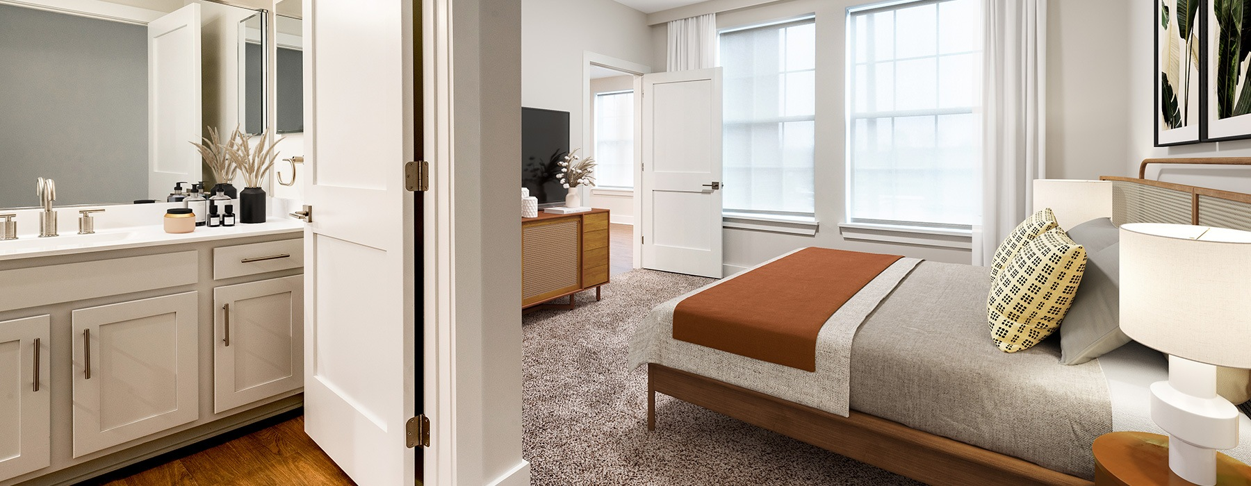 bedroom with double-door opening to bathroom and spacious areas